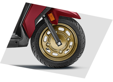 TELESCOPIC SUSPENSION AND FRONT 90/90-12 TUBELESS TYRE  The new DIO is equipped with a Telescopic Suspension for less shock and more awe while riding. Its bigger front wheel helps to negotiate with the nastiest potholes while providing a better road grip & excellent handling conditions